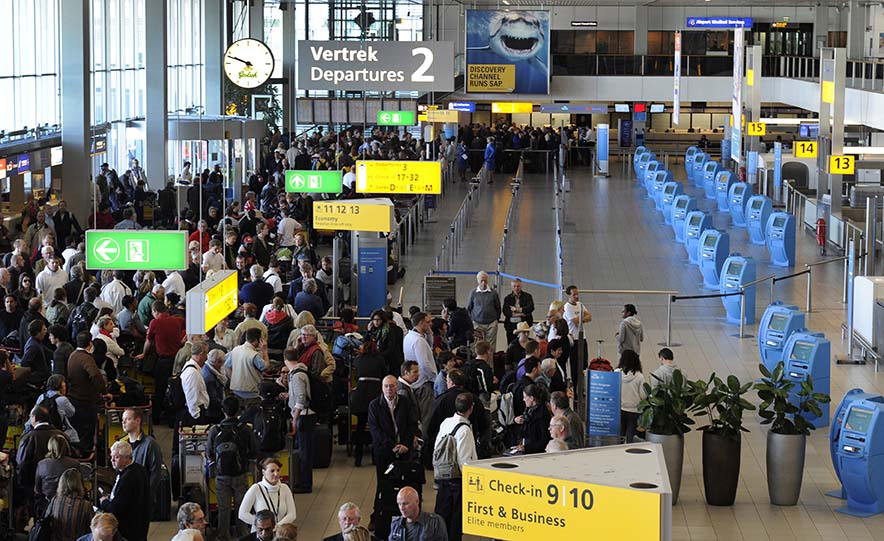 Passengers wait after the cancellation of flights at Schiphol Airport in Amsterdam, Netherlands